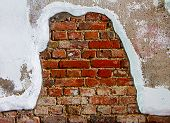 Old Plaster On Red Brick Wall