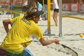 MOSCOW, RUSSIA - JULY 16, 2014: Vinicius Font of Brazil on the training before the ITF Beach Tennis