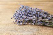 Lavender flowers on color wooden background