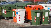 stock photo of dumpster  - Sorting and recycling garbage bins and dumpster - JPG