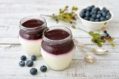 pic of panna  - Dessert panna cotta with fresh blueberry on wooden background - JPG