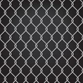 stock photo of chain link fence  - metal chain link fence on black - JPG