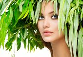 Beauty Girl with green leaves on her head. Beauty summer woman portrait. Beauty model  in green wrea
