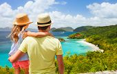 Family of father and daughter enjoying aerial view of picturesque Trunk bay on St John island, US Vi