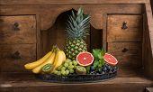Fruits (pineapple, Banana, Grapes, Kiwi, Grapefruit) On A Dish