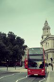 Double deck bus and historical buildings in London Street