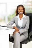attractive african female business executive in modern office