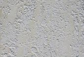 Yellow rough plaster on wall