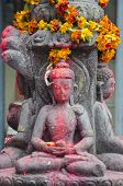 Buddha Statue With Flowers In Katmandu Old Town