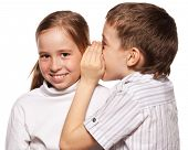 Boy whispers girl in the ear secret. Childrens gossip