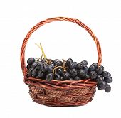 Red grapes in wicker basket.