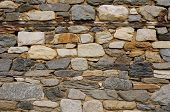 stock photo of gneiss  - Old xolorful stone wall with wooden beams - JPG