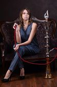 The beautiful sensual woman with a hookah