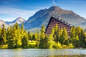 Fantastic mountain lake in National Park High Tatra. Dramatic scenery. Strbske pleso, Slovakia, Euro