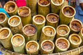 Glutinous Rice Roasted In Bamboo Joints (khoalam)