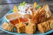 Tofu, Sausage, Pork Dumpling Fried And Salad