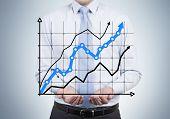Businessman Holding Chart