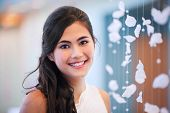 Beautiful Biracial Bride Smiling Next To Curtain Of White Rose Petals
