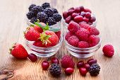 image of dogwood  - strawberries dogwood and raspberries in bowls close - JPG