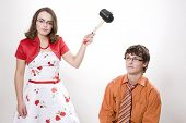 picture of adversity humor  - Young pretty wife strikes her husband in studio - JPG