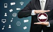 Businessman Holding Cloud Computing Network