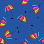 Seamless pattern with umbrellas on background