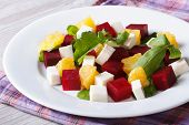 Fresh Beet Salad With Oranges, Cheese And Arugula On A Table