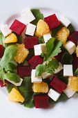 Beet Salad With Cheese And Arugula. Vertical Top View Closeup