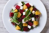 Beet Salad With Cheese And Arugula. Horizontal Top View Closeup