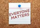 pic of all-inclusive  - The phrase Everyone Matters in red ink on a lined index card pinned to a cork notice board - JPG