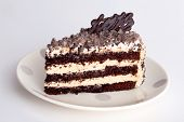 stock photo of fancy cake  - honey cake with chocolate frosting white and black - JPG