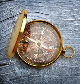 Compass On Gray Wooden Background