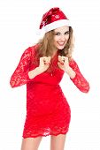 Excited Woman In Santa Hat With Clenched Fists