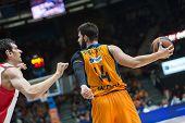 VALENCIA, SPAIN - DECEMBER 5: Dubljevic with ball during Euroleague match between Valencia Basket Club and Crvena Zvezda Telekom Belgrade at Fonteta Stadium on Dicember 5, 2014 in Valencia, Spain