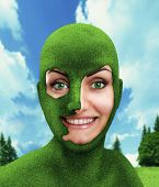 Green woman's head on nature