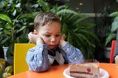 Upset Boy In Cafe