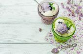 blueberry ice cream on wooden background