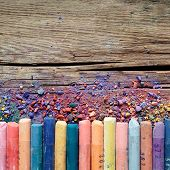 pic of pigment  - Artistic pastel crayons and pigment dust on old rustic wooden background - JPG