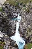 Blue river and two waterfalls in one of the National Park in Norway.