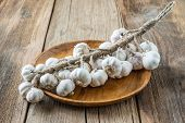 Bunch Of Dried Garlic Bulbs On A Wooden Tray
