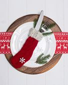 Christmas cutlery place setting in knitted stocking