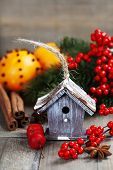 Bright christmas composition with small bird house and mulled wine