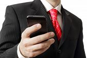 Businessman holding a cell phone close-up