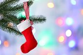 Christmas handmade decorations hanging on Christmas tree on blurred background