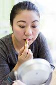 Asian Makeup Woman Putting Lipstick