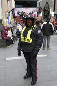 Unidentified security officer providing security at Times Square area in Midtown Manhattan