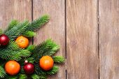 Fresh ripe mandarins  and fir tree bud on wooden background