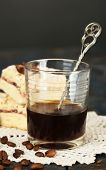 Glass of espresso and tasty homemade pie on wooden table
