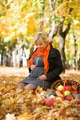 pregnant woman in autumn park