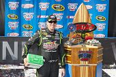 Fontana, CA - Mar 23, 2014:  Kyle Busch (18) wins the
